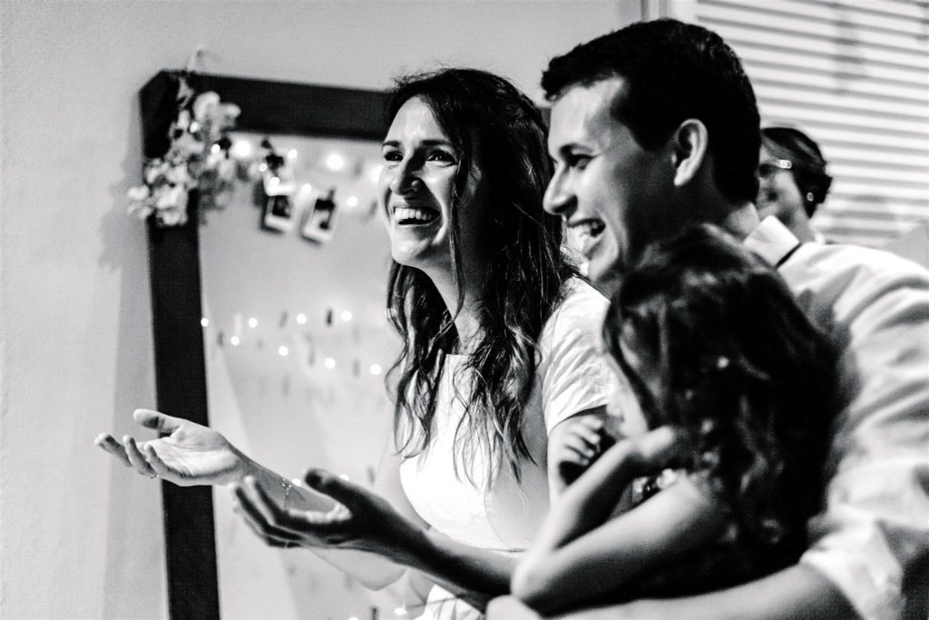 the bride and groom surprised by the brother's gift